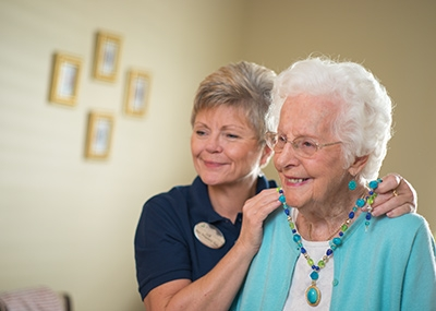 Caregiver assisting resident