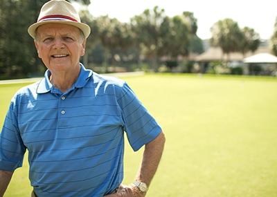 Man wearing golf hat.